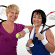 Stock Photo: Friends playing tennis
