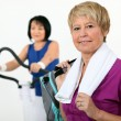 Stock Photo: Two middle-aged women at gym