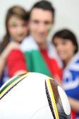 Football fans holding a ball — Stock Photo