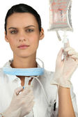 Nurse preparing IV drip — Stock Photo