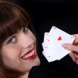 Woman holding playing cards — Stock Photo