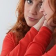 Redhead looking in a mirror — Stock Photo #16532109