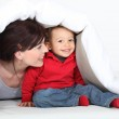 A mother and his son under a blanket. — Stock Photo #16542221