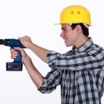 Tradesman holding a power tool — Stock Photo