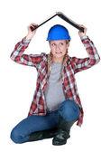 Tradeswoman covering her head — Stock Photo