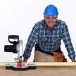 Man with circular saw - Stock Photo