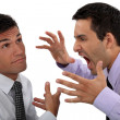 Man yelling at his apathetic colleague — Stock Photo #16558791