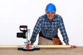 Man with circular saw — Stock Photo