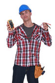 Electrician holding a measurement tool — Stock Photo