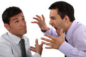 Man yelling at his apathetic colleague — Stock Photo
