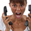 Woman screaming in frustration - Stock Photo