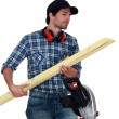 Carpenter cutting wooden slats - Stock Photo
