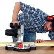 Man using circular saw - Stock Photo