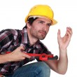 Worker crouched — Stock Photo #16571963