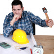 Stock Photo: Architect smashing alarm with hammer