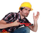 Worker crouched — Stock Photo