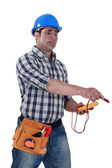Electrician with a voltmeter — Stock Photo