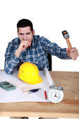 Architect smashing alarm with hammer — Stock Photo
