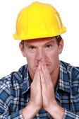 Construction worker praying — Stock Photo