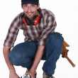 A handyman using a sander - Stock Photo