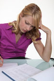 Woman filling in paperwork — Stock Photo