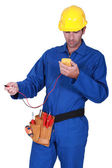 Electrician with tester — Stock Photo