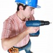 图库照片: Construction worker holding power tool