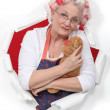 Stock Photo: Elderly woman holding teddy