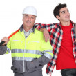 Stock Photo: Builder stood with new employee