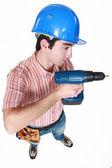 Um trabalhador da construção civil tem uma broca — Foto Stock