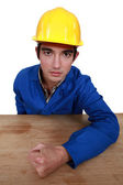 Builder hitting table with fist — Stock Photo