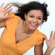 Happy woman raising hands — Stock Photo