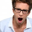 Man in glasses yawning — Stock Photo #16602441