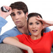 Scared couple watching television — Stock Photo #16603181