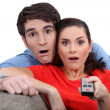 Couple staring at the screen in disbelief — Stock Photo #16603423