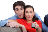 Couple staring at the screen in disbelief — Stock Photo