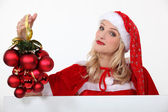 Woman dressed in festive outfit — Stock Photo