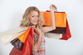 A smiling woman who enjoyed a shopping spree. — Stock Photo