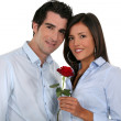Couple with a red rose — Stock Photo #16613423