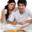 Stock Photo: Couple having breakfast in bed