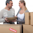 Couple moving in to new home — Stock Photo