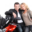 Stock Photo: Biker chic leaning on biker