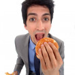 Businessman eating junk food — Stock Photo