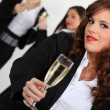 Three businesswomen with champagne — Stockfoto