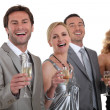 Group of drinking champagne — Stock Photo