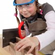 Foto Stock: Schoolgirl dressed as joiner