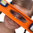 Stock Photo: Girl with a spirit level