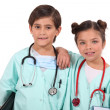 Kids dressed up as doctors — Stock Photo