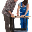 Carpenter and his apprentice — Stock Photo #16618899