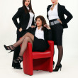 Three sexy woman in a suit — Stock Photo